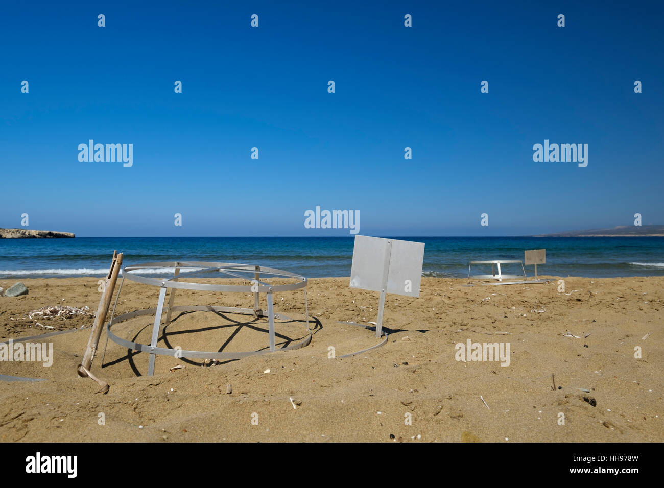 with iron racks protected sea turtles nests on the beach in Cyprus Stock Photo
