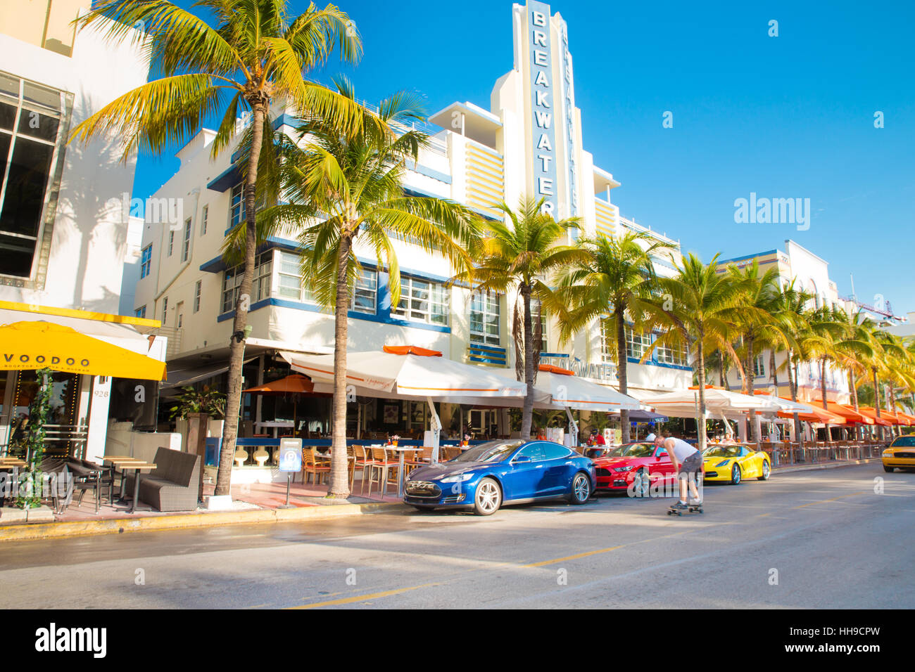 View along the famous vacation and tourist location on Ocean Drive in the Art Deco district of South Beach, Miami - Stock Image