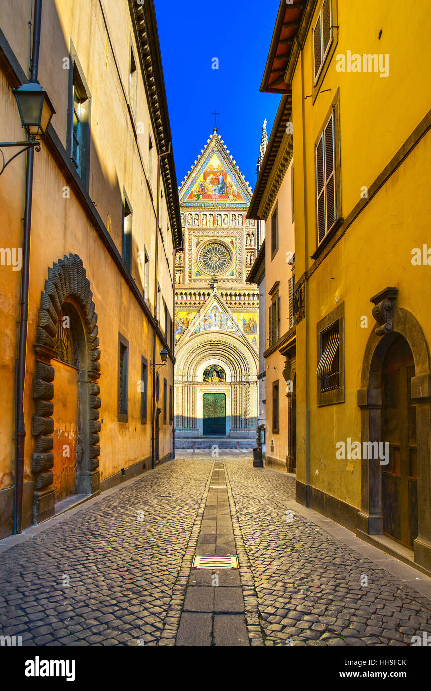 Orvieto medieval Duomo cathedral church landmark facade view from a street. Umbria, Italy, Europe. - Stock Image