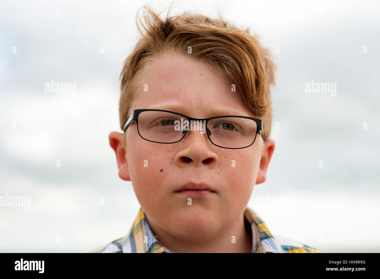 b7494db3f85f 11-year old ginger haired boy wearing glasses Stock Photo: 131137596 ...