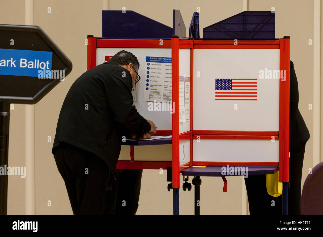 Man casting vote at ballot box during 2016 general elections - Arlington, Virginia USA - Stock Image