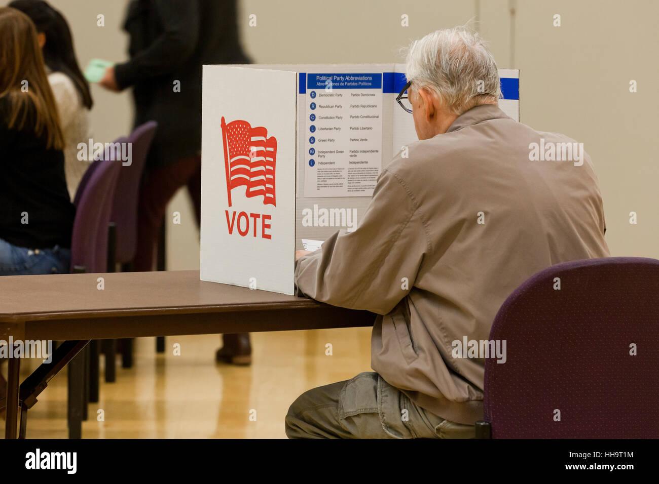 Senior man casting vote at ballot box during 2016 general elections - Arlington, Virginia USA - Stock Image