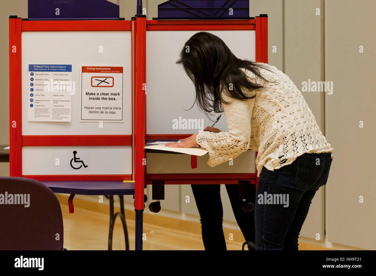 Female voter at ballot box during 2016 general elections - Arlington, Virginia USA - Stock Image