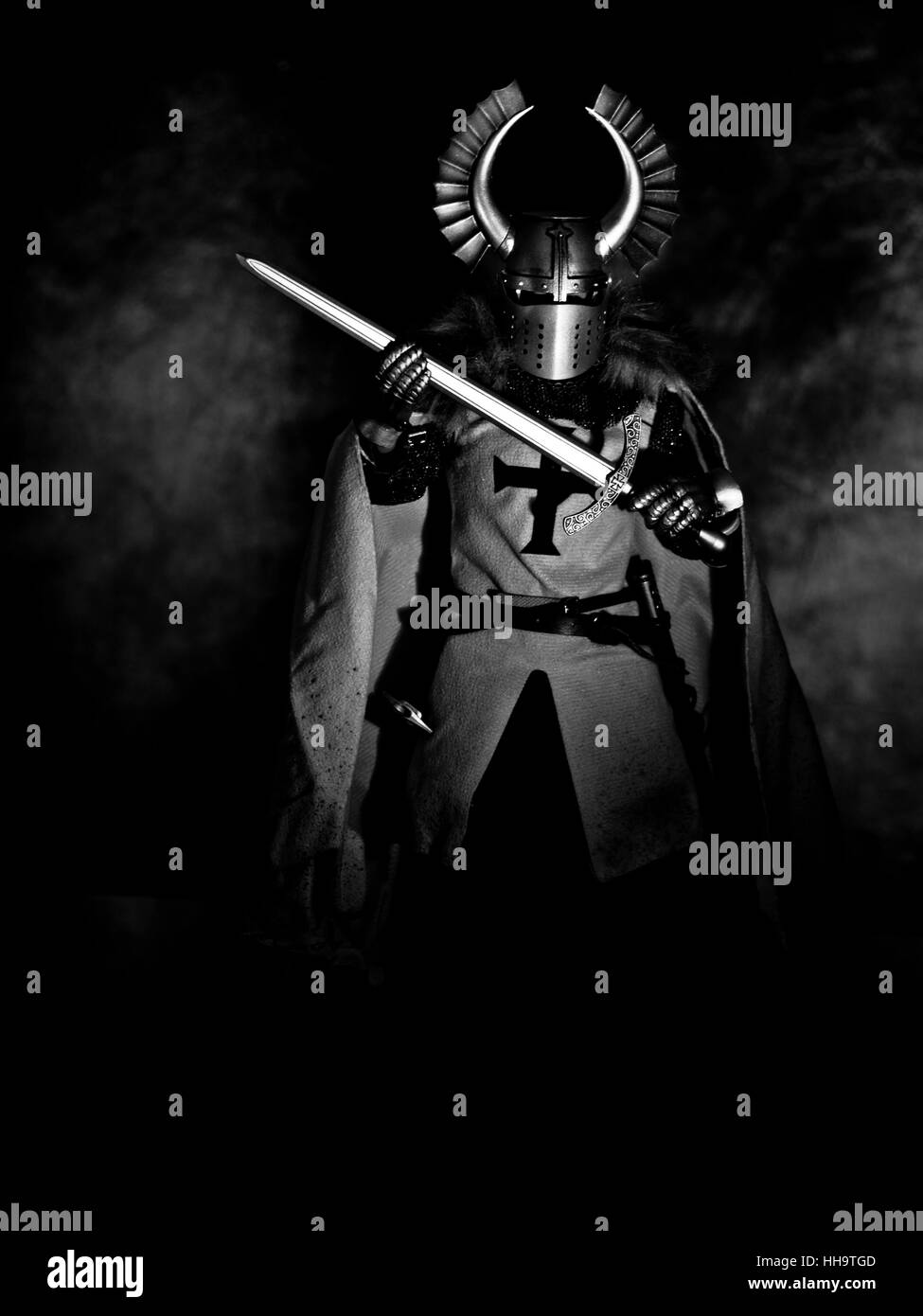 Teutonic Knight in armor, plate and with a sword - Stock Image