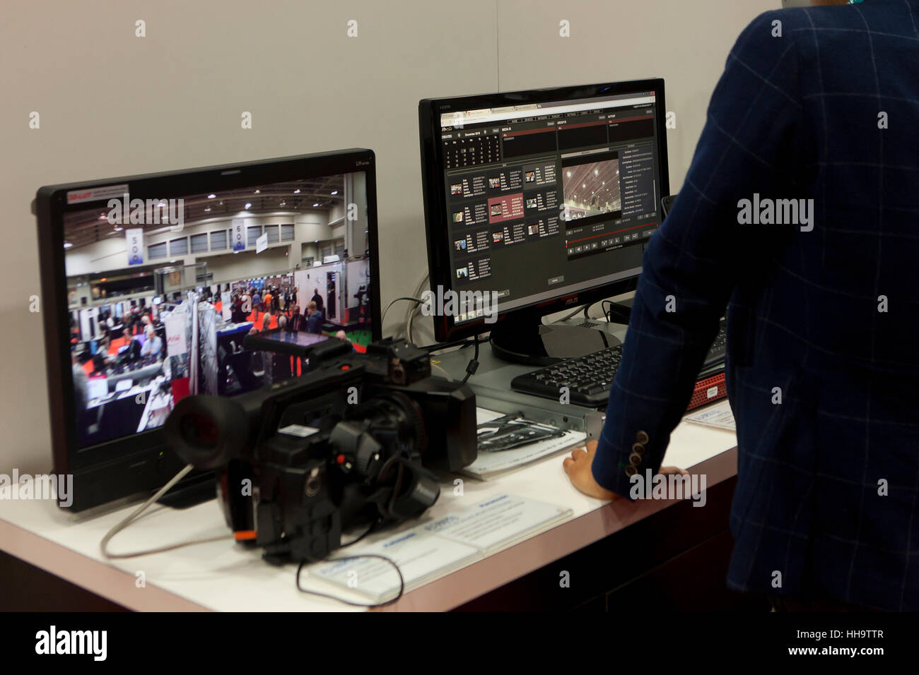 Computer workstation showing video editing software on screen - USA - Stock Image