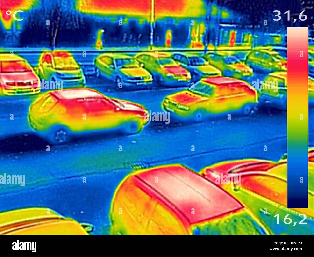 Thermal image showing parked cars at town parking lot - Stock Image