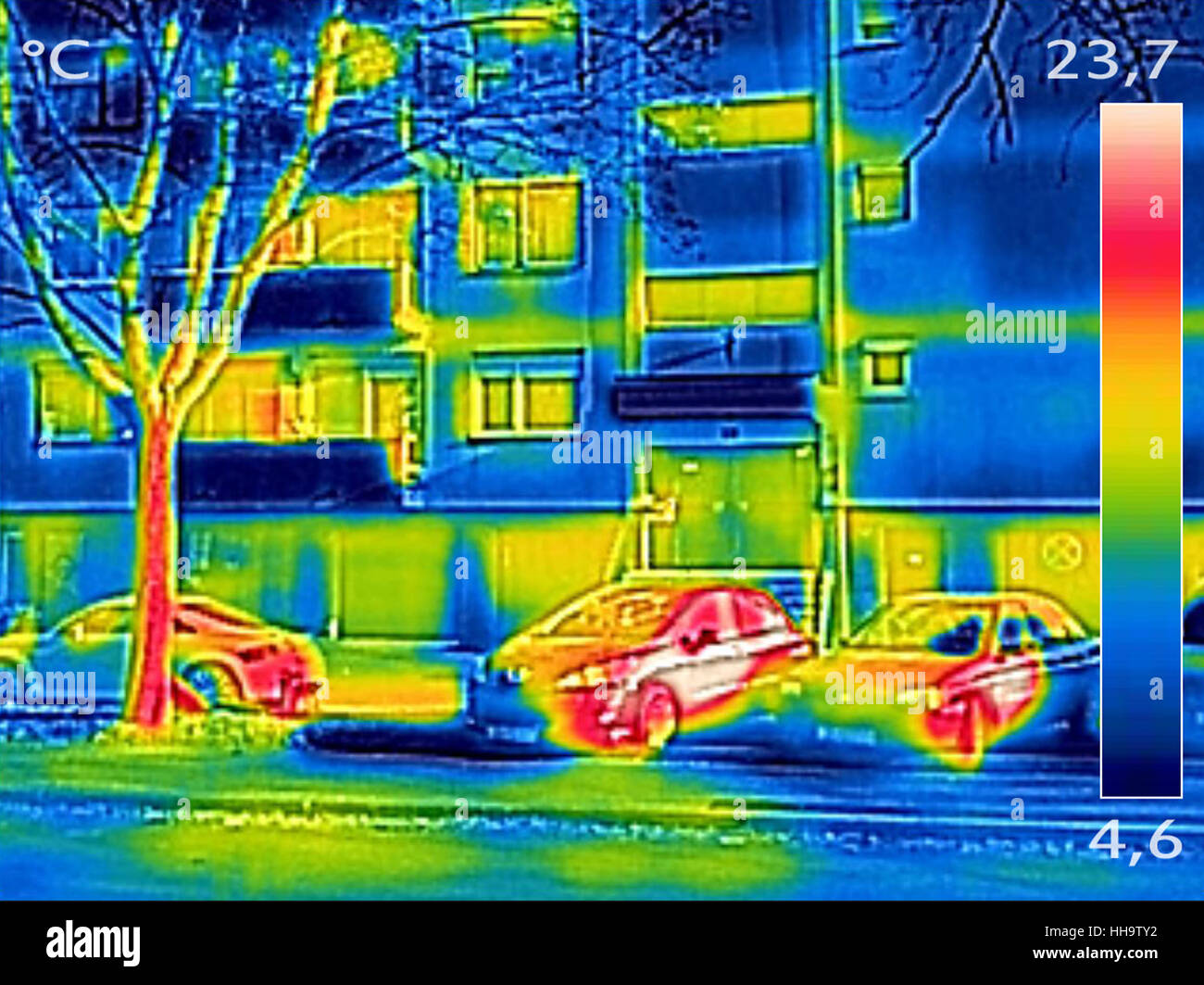 Thermal image showing parked cars in front of the apartment building - Stock Image