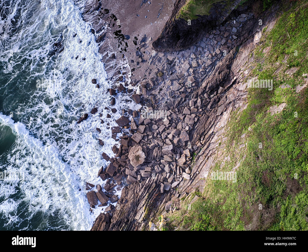 Cornish cliffside with rocks aerial photo Stock Photo