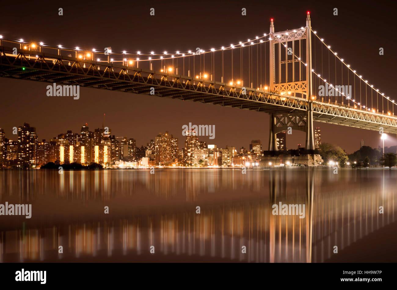 Beautiful night view of New York City with lights of Robert F. Kennedy RFK bridge aka the Triborough bridge - Stock Image