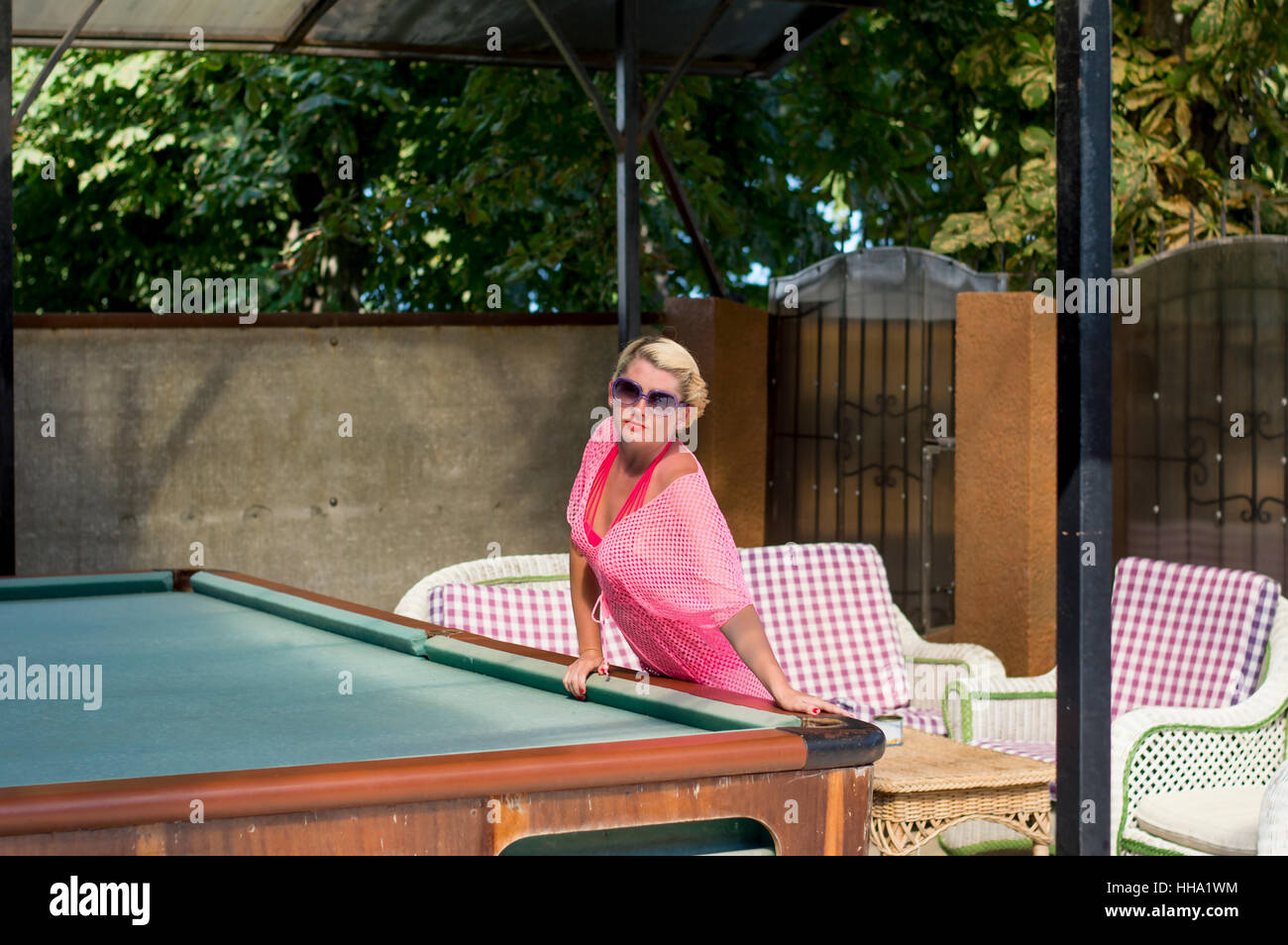 the beautiful woman rests on a billiard table - Stock Image