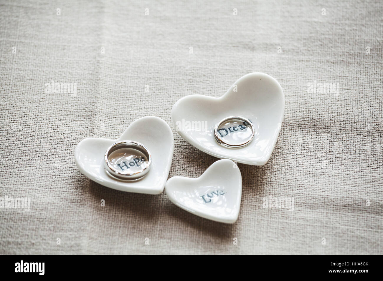 Wedding Rings On A Heart Shapes Recipient Decorations Inscribed With Hope Dream Love Words