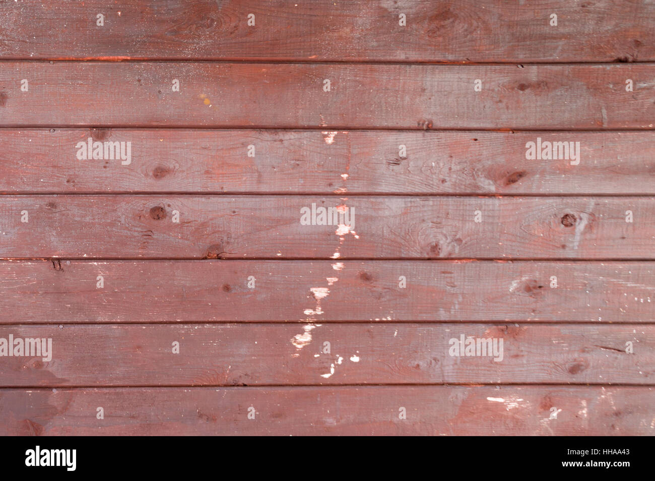 7 horizontal red worn painted wooden boards or planks rustic rural background - Stock Image