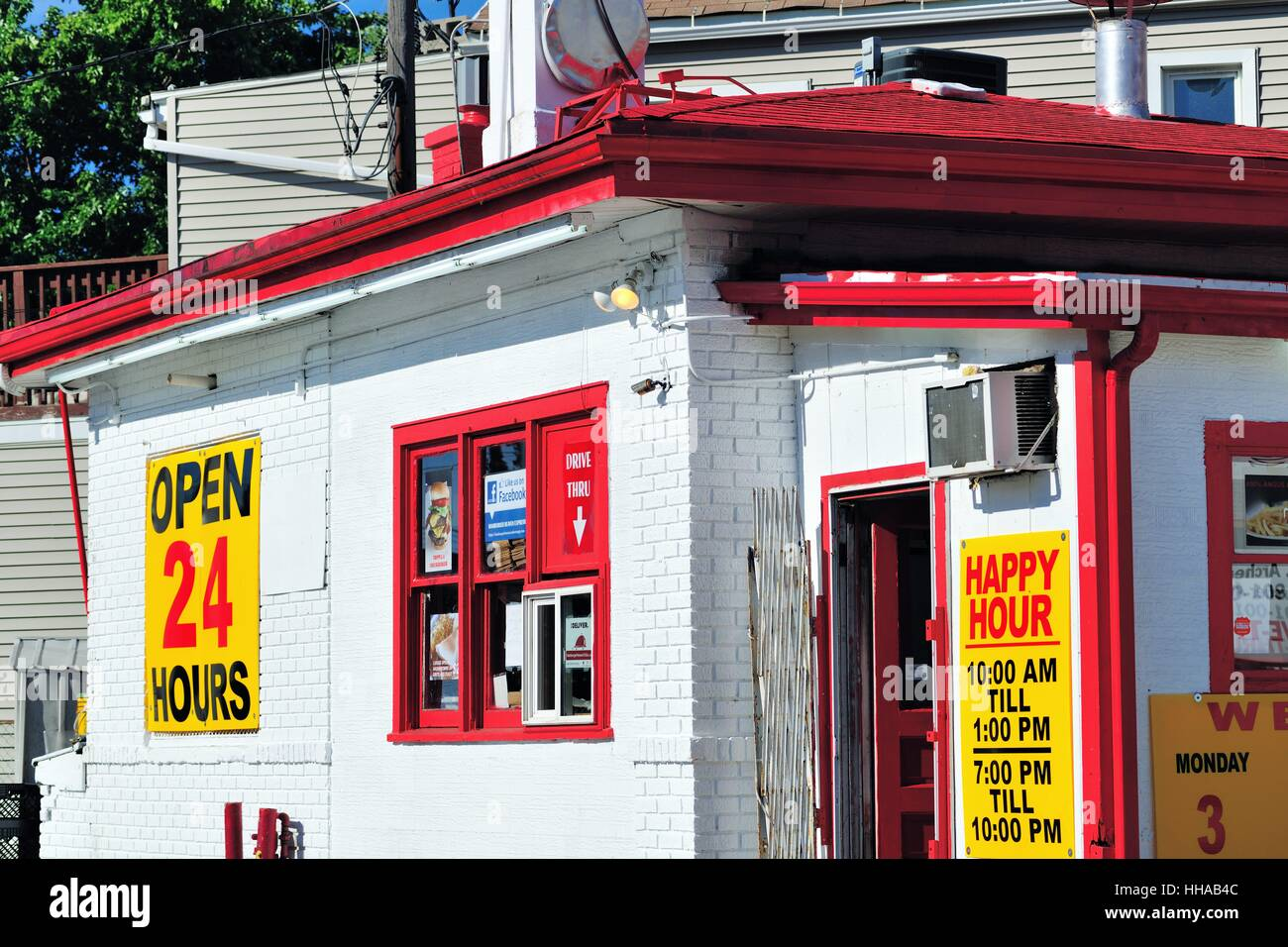 A small, colorfully trimmed drive-through restaurant establishment with extended happy hour periods in Chicago, - Stock Image