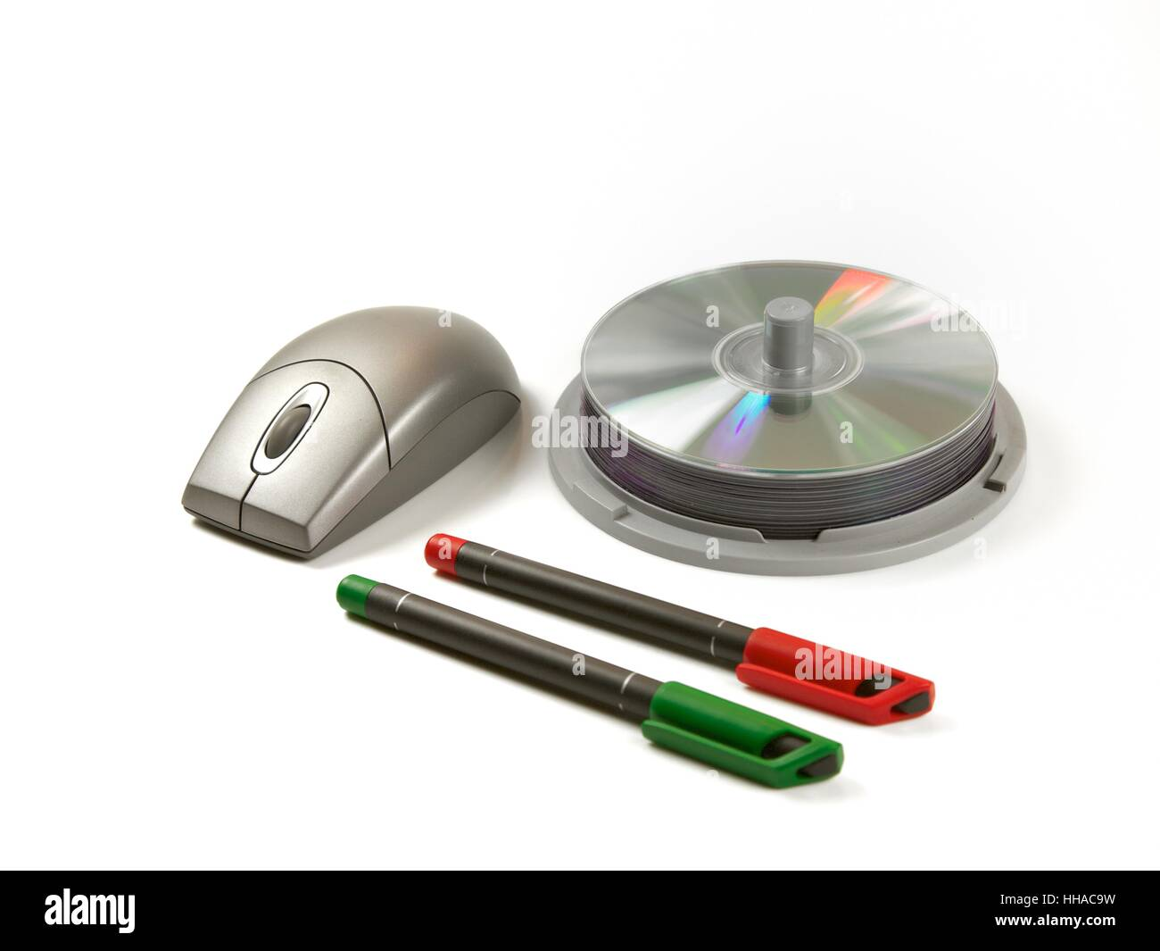Stationery General Daily Usage CD CD pen and Computer Mouse on the Office Desk - Stock Image