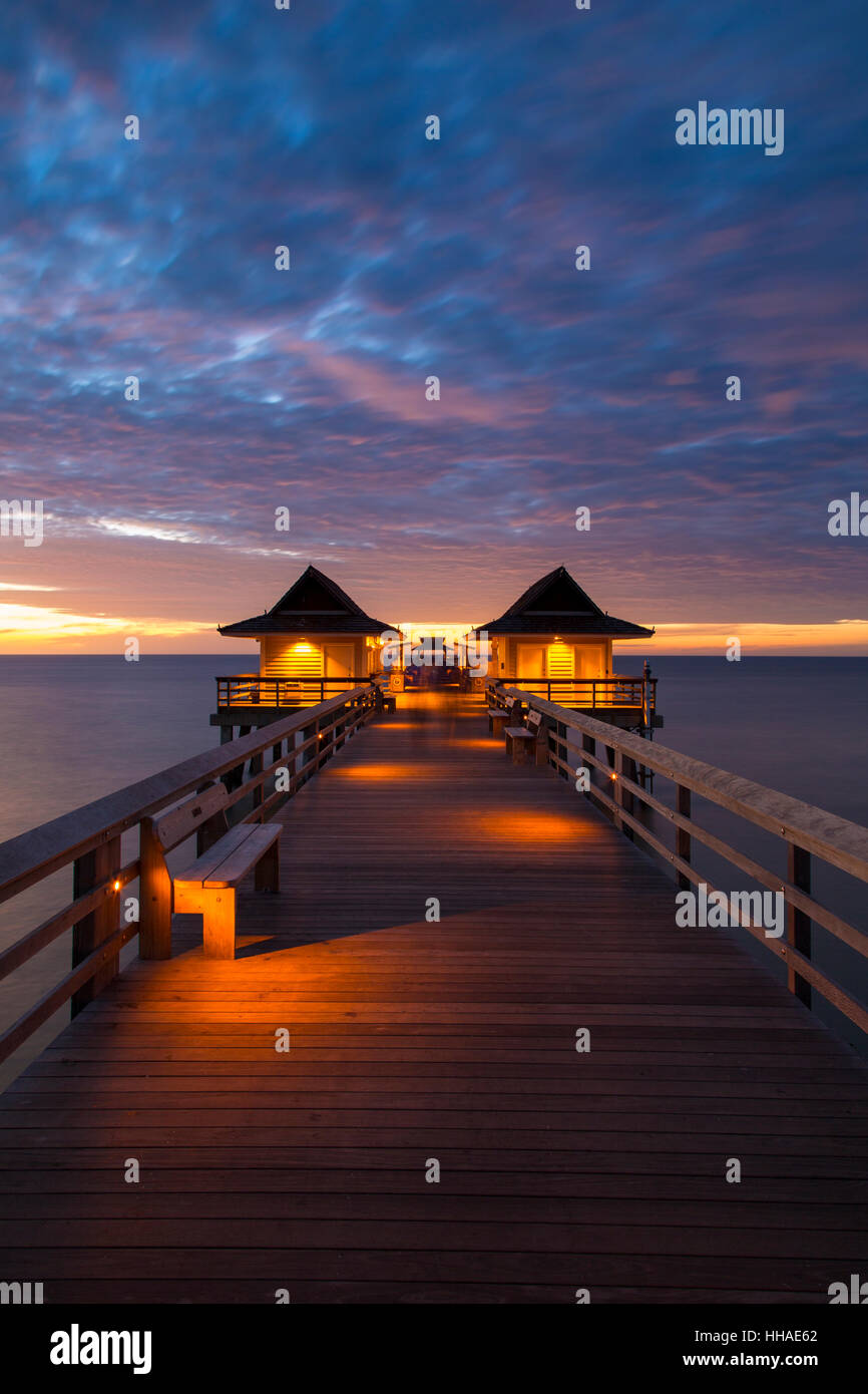 Dusk over the pier and Gulf of Mexico from Naples, Florida, USA - Stock Image