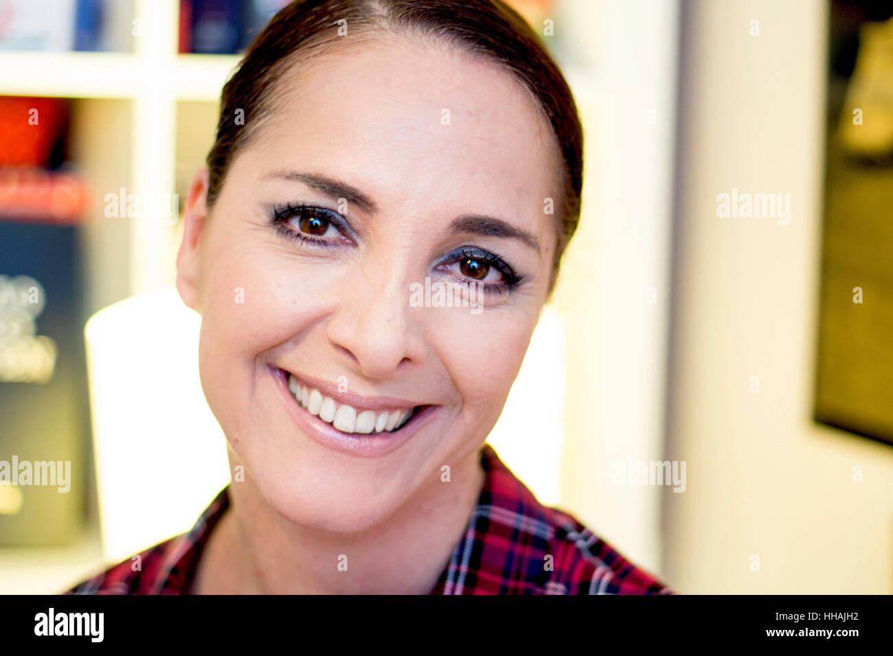 Portrait of a woman smiling, happy, looking at camera, mid aged. - Stock Image