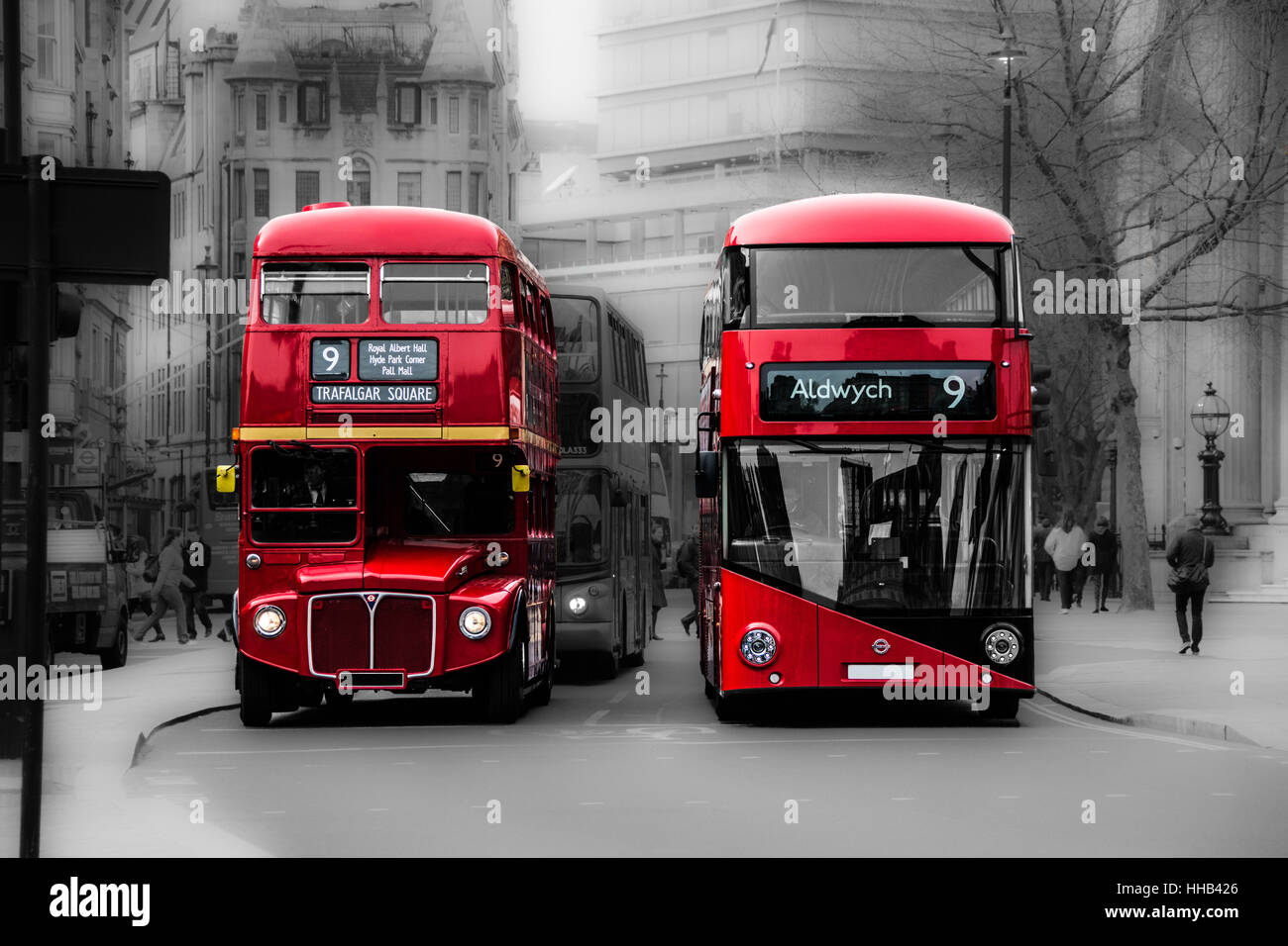 London, UK. Old & new London red buses stop side by side at a traffic light in Trafalgar Square, London - Stock Image