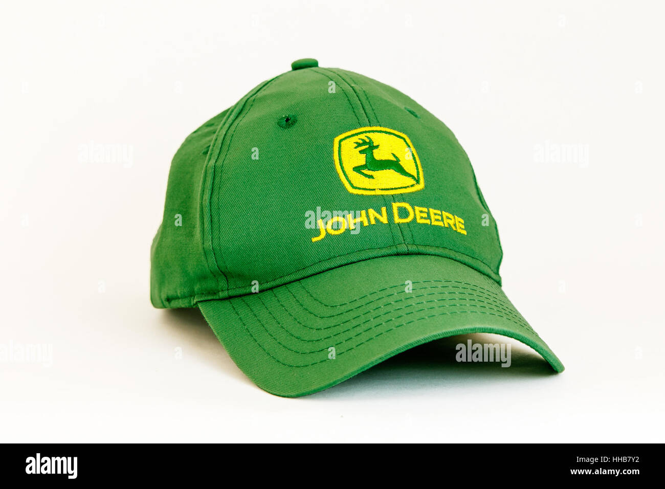 A John Deere branded green baseball cap is seen against white background. -  Stock Image 6a198b94e75