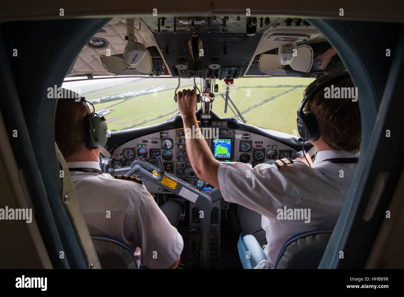 Aircraft Cockpit with pilots - Stock Image