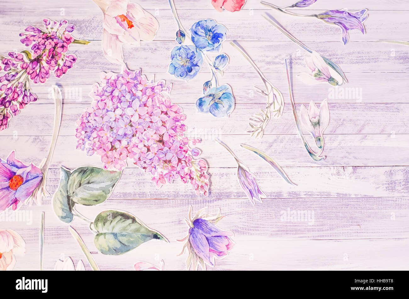Spring floral decoration with watercolor paper purple flowers on a spring floral decoration with watercolor paper purple flowers on a white rustic wooden background natural collage top view copy space selective fo mightylinksfo