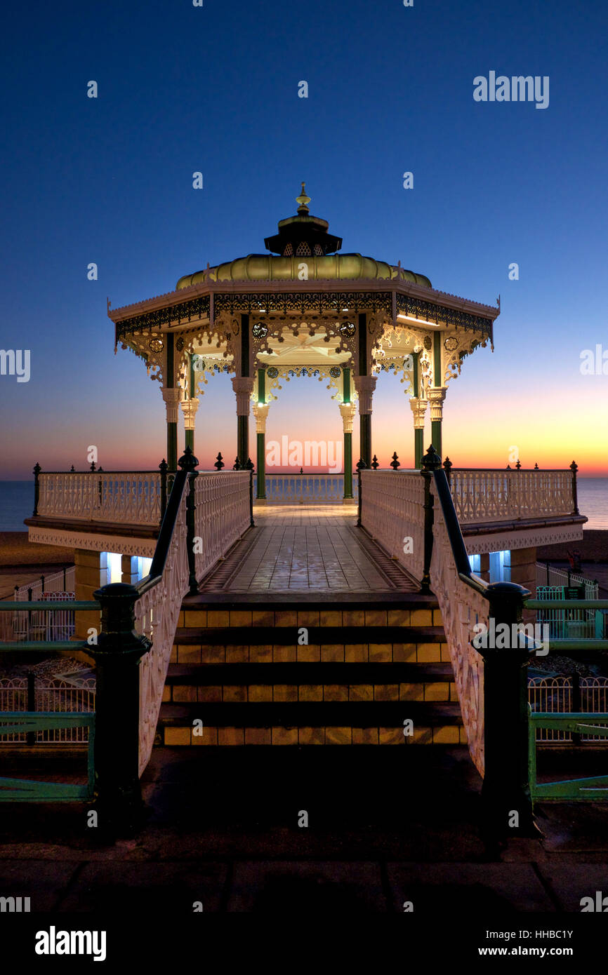 Brighton Victorian bandstand at sunset, also known as birdcage bandstand, the bandstand newly refurbished and is - Stock Image