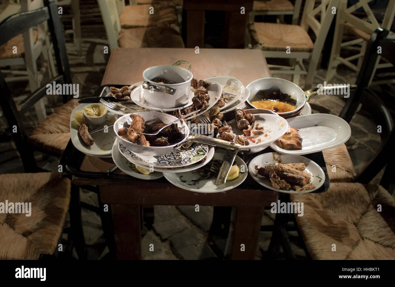 Leftover Food On Stacked Plates In A Restaurant Greek Taverna