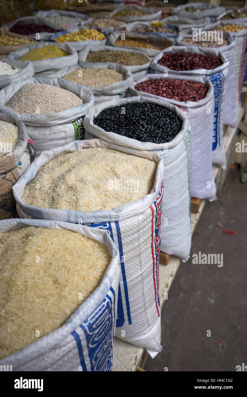 Sacs of dry goods at the farmers market in Otavalo Ecuador - Stock Image
