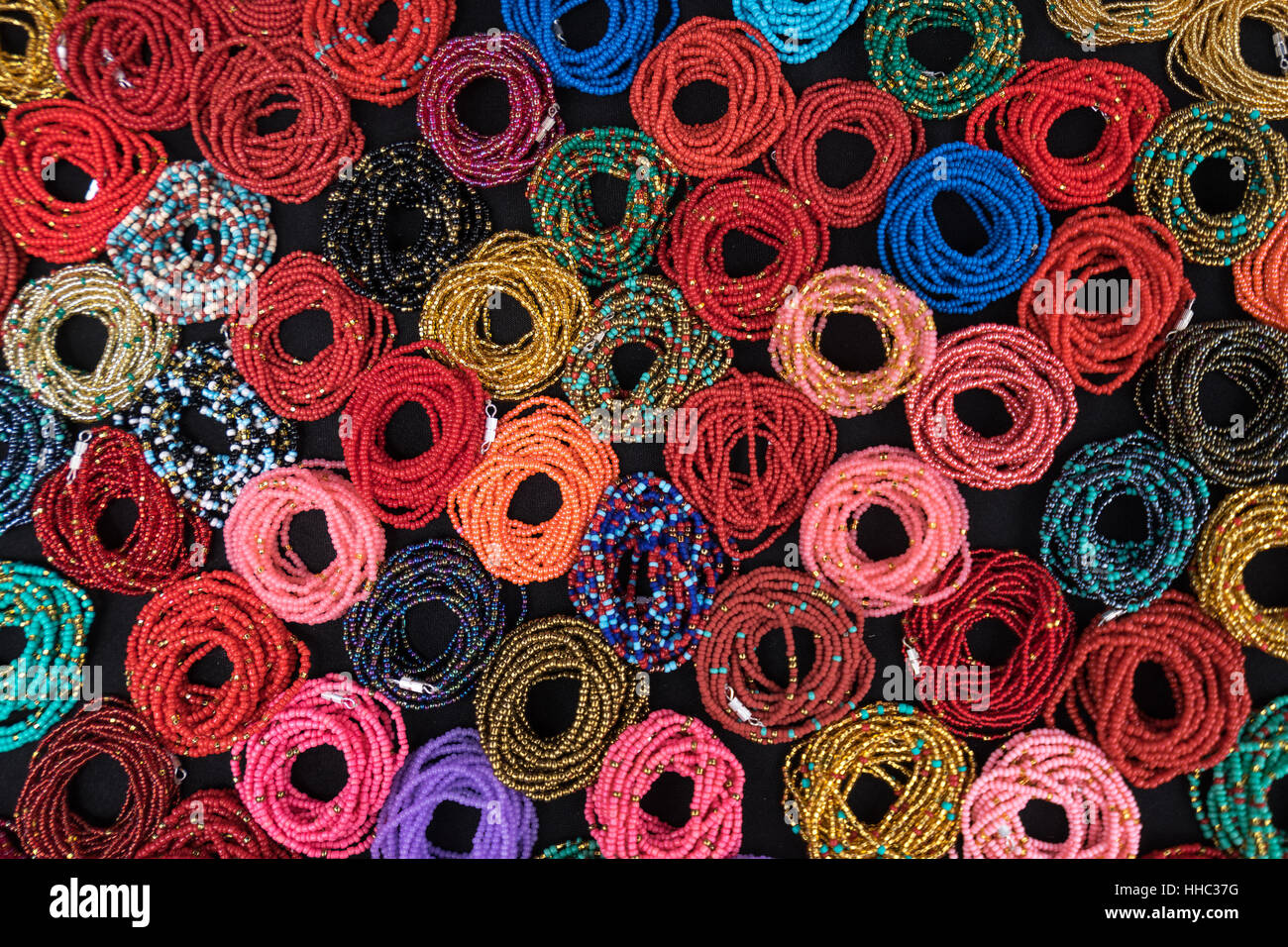 pattern created by colorful bracelets in Otavalo Ecuador - Stock Image