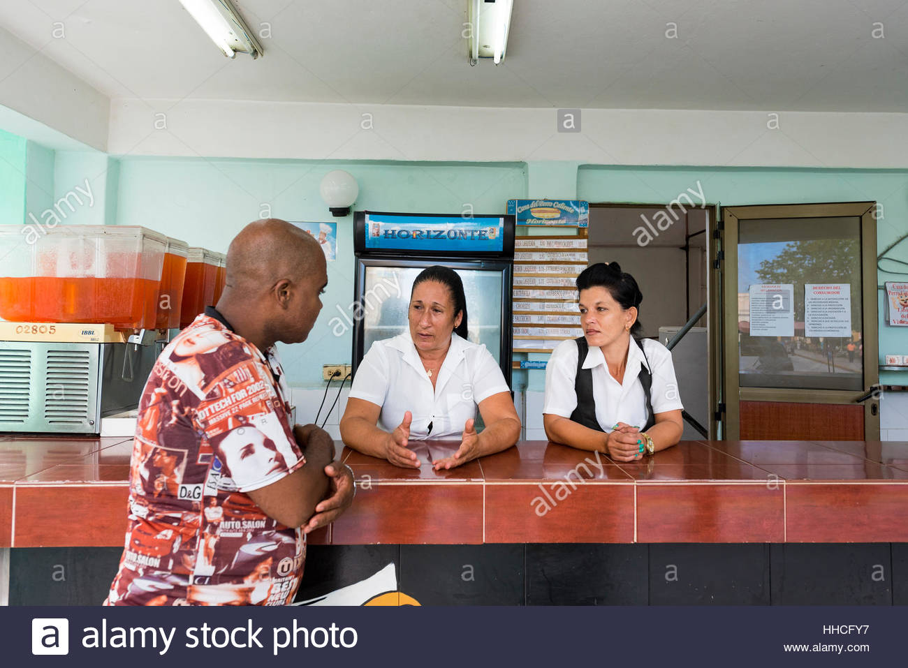 Cuban gastronomic employees talking doing nothing. Cuban real people lifestyle in the Caribbean Island. - Stock Image