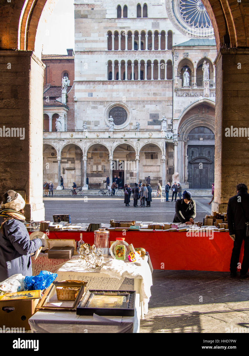 Book seller in street market, winter time, Lombardy, Italy - Stock Image