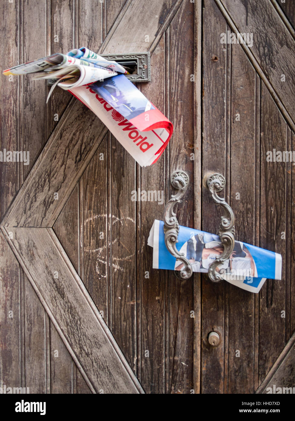 Junk mail in door handle or posto boxes in Italy. - Stock Image