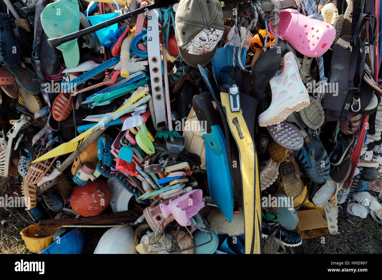 Man made plastic beach debris collected from the coastline. - Stock Image