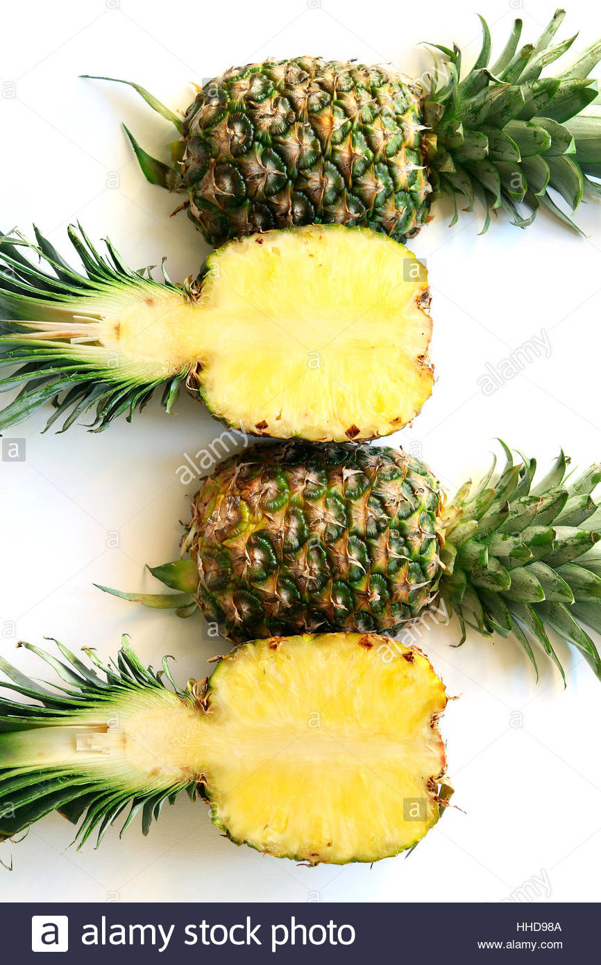 Half fresh pineapple on white background.Top view - Stock Image