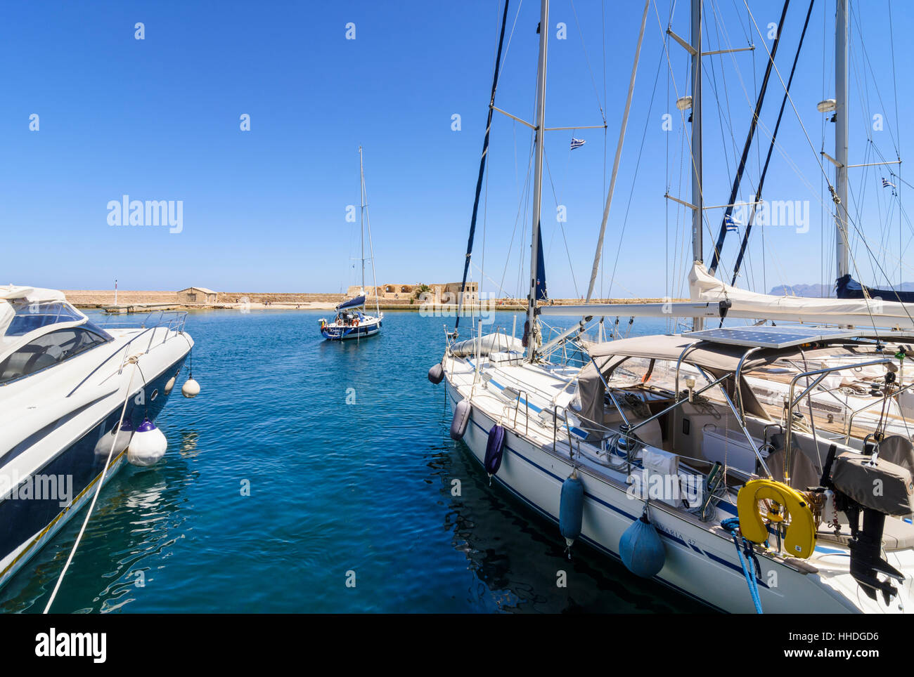 Yachts and boats in the inner harbour of the old Venetian port of Chania, Crete, Greece - Stock Image