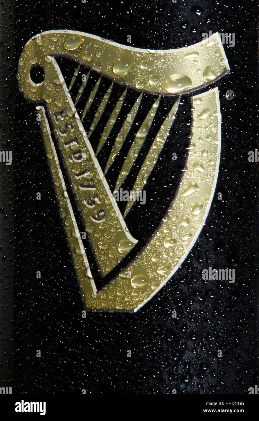 Close-Up of the Harp Logo on the side of a freshly poured pint of Guiness - Stock Image