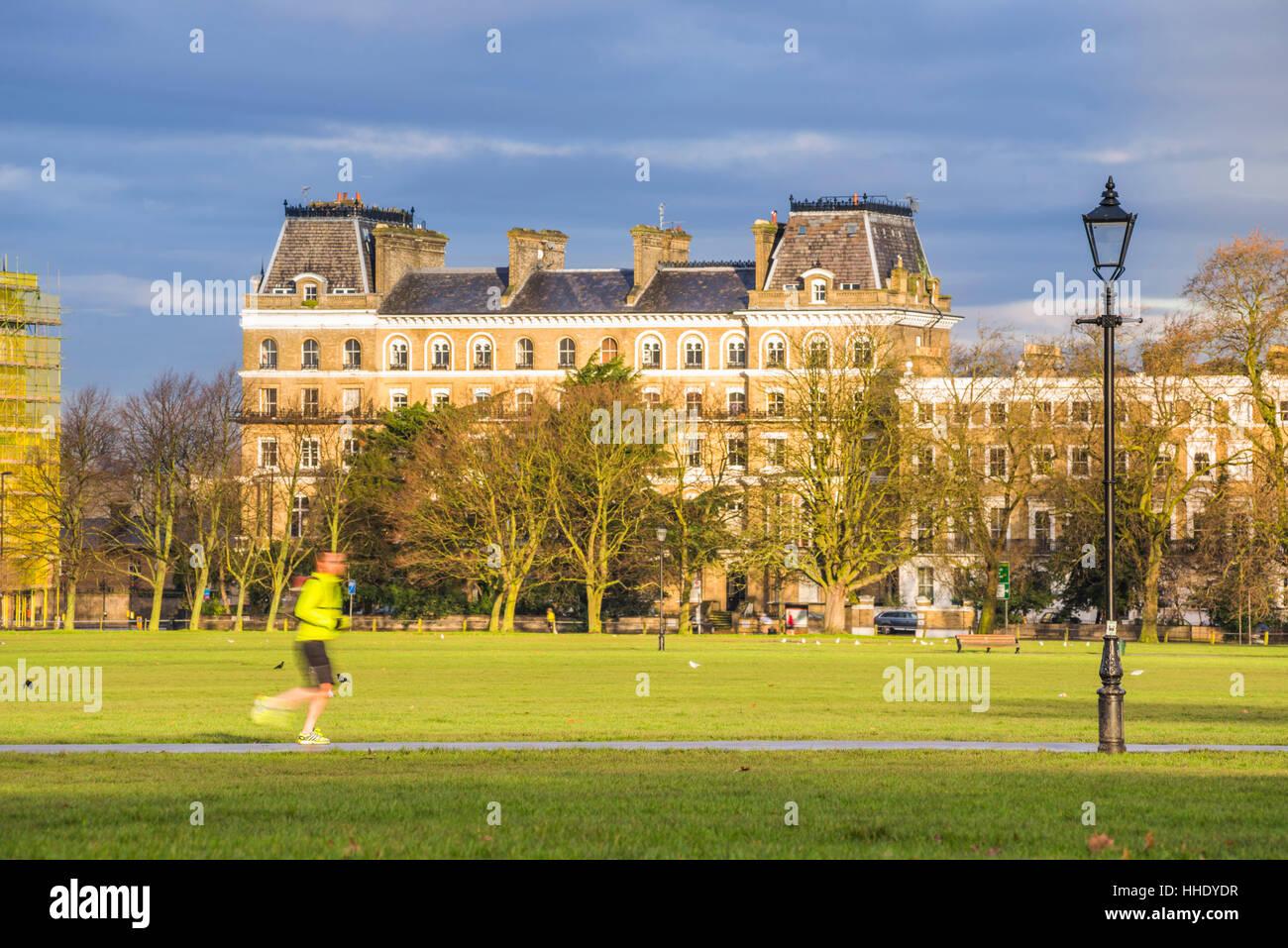 Jogger jogging on Clapham Common, Lambeth Borough, London, UK - Stock Image