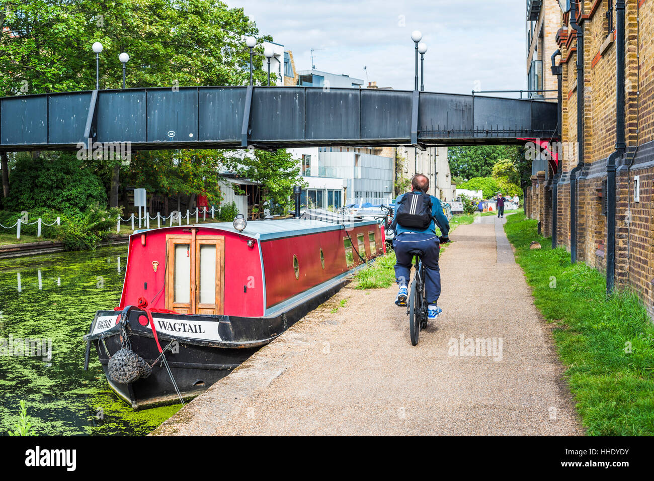 Cycling by the Canal at Ladbroke Grove in the Royal Borough of Kensington and Chelsea, London, UK Stock Photo