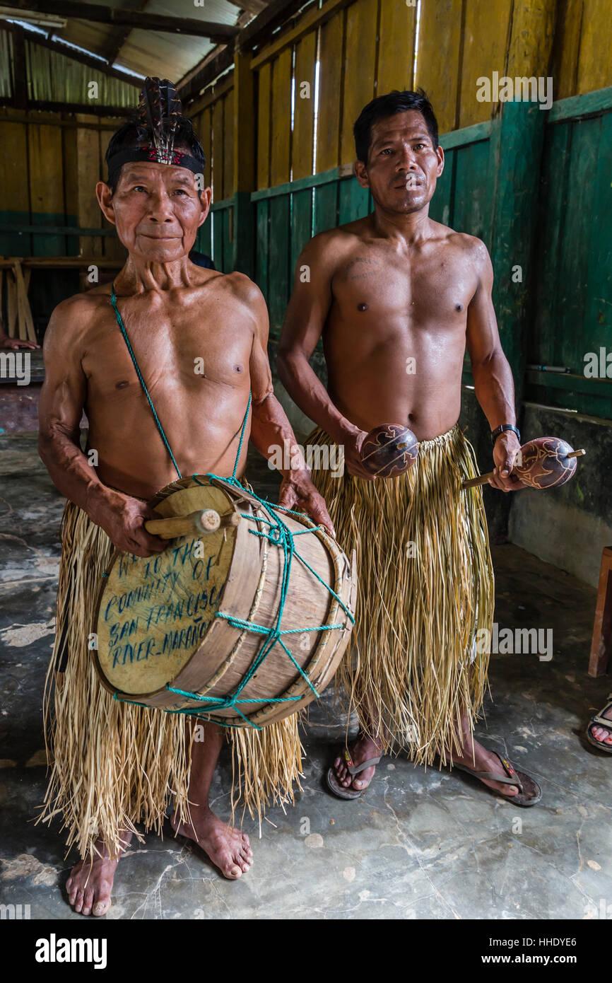 Traditional musicians perform in San Francisco Village, Loreto, Peru - Stock Image