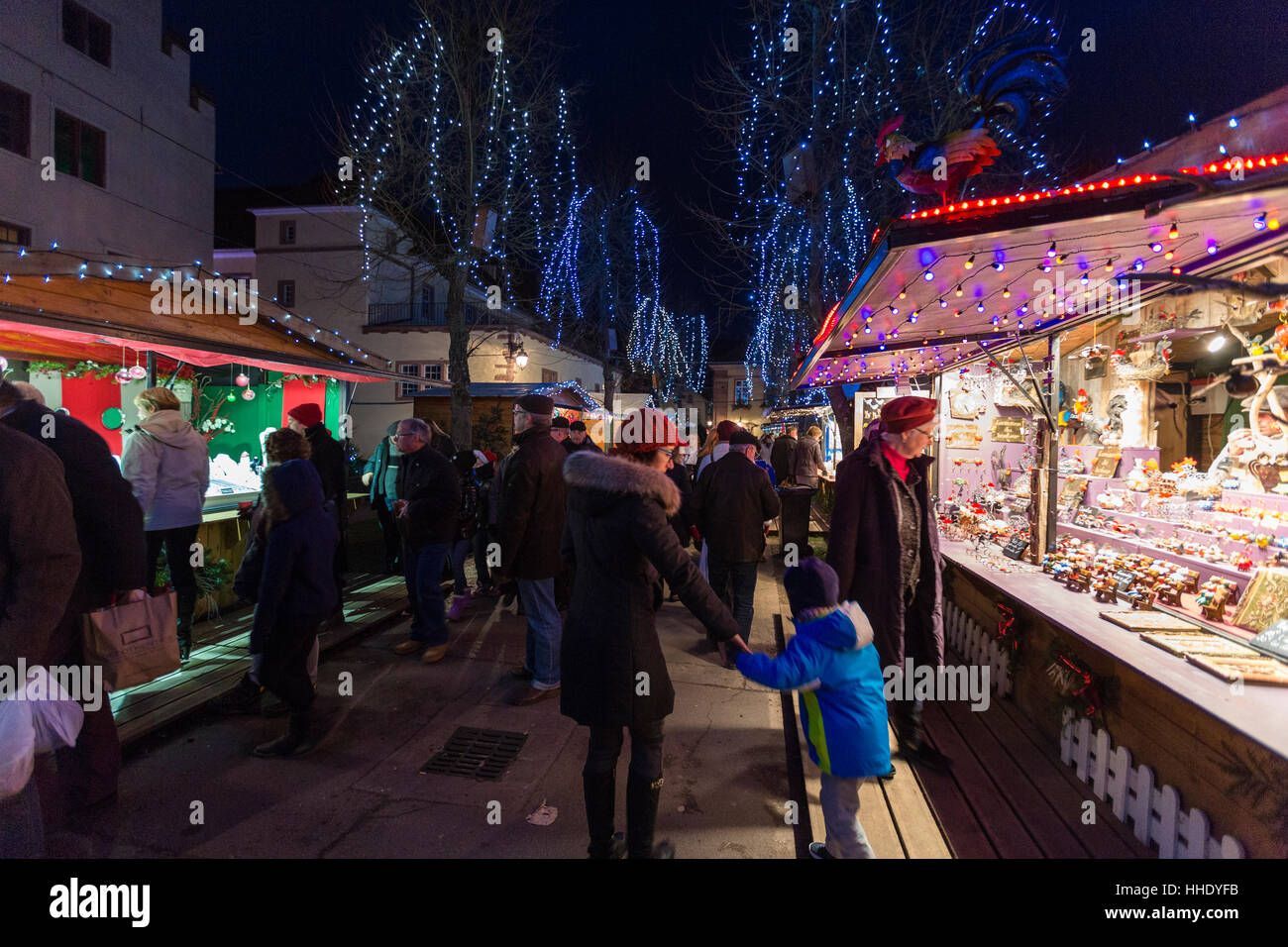 Tourists and Christmas Markets in the old medieval town of Riquewihr, Haut-Rhin department, Alsace, France - Stock Image