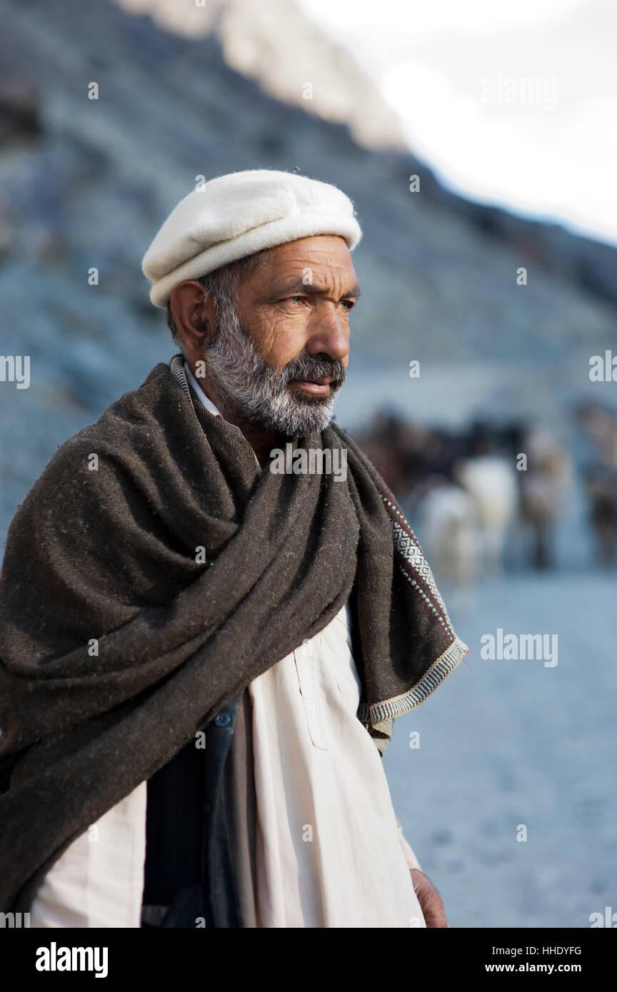 A shepherd near Gilgit, Gilgit-Baltistan, Pakistan Stock Photo