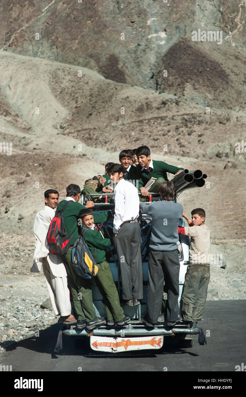 Children overload a local bus to get to school , Gilgit-Baltistan, Pakistan - Stock Image