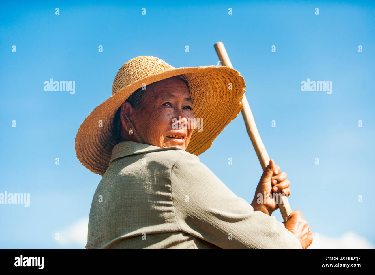A farmer with a hand tool in Yunnan Province, China - Stock Image