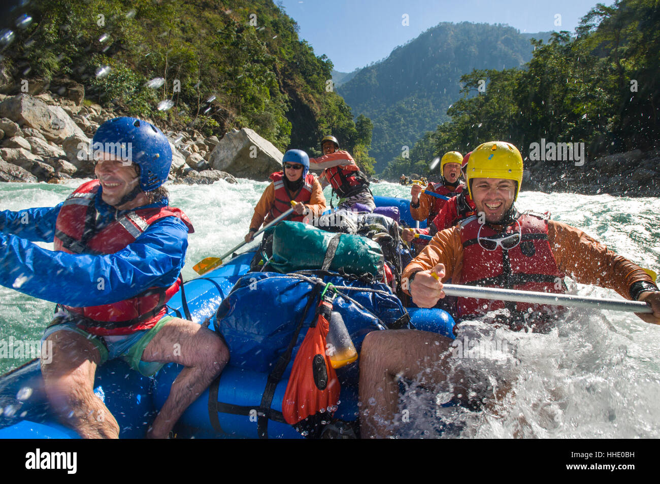 Rafters get splashed as they go through some big rapids on the Karnali River, west Nepal - Stock Image