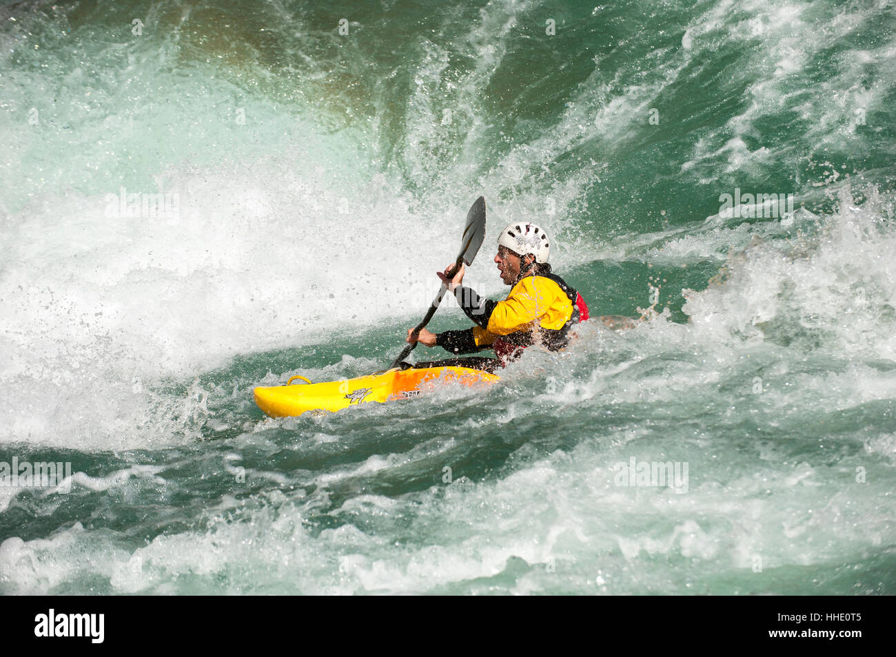 A kayaker negotiates his way through the rapids on the Karnali River, west Nepal - Stock Image