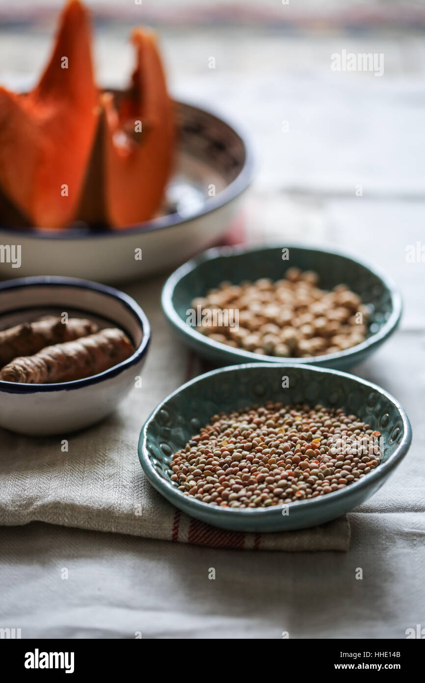Lentils in a blue bowl - Stock Image