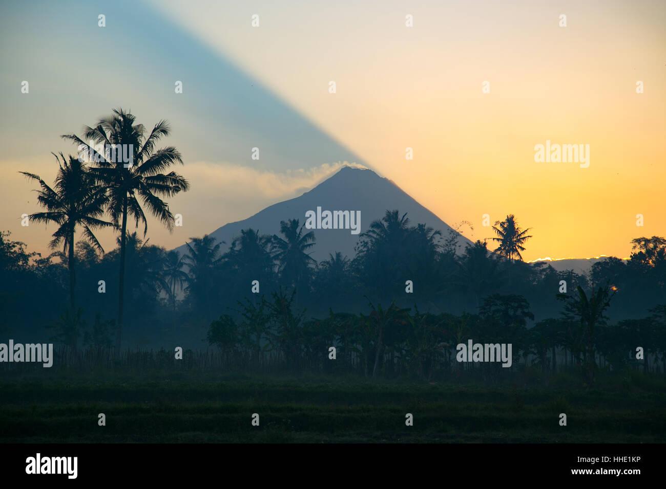 Sun Rising Over Mount Merapi Volcano Central Java Indonesia - Stock Image