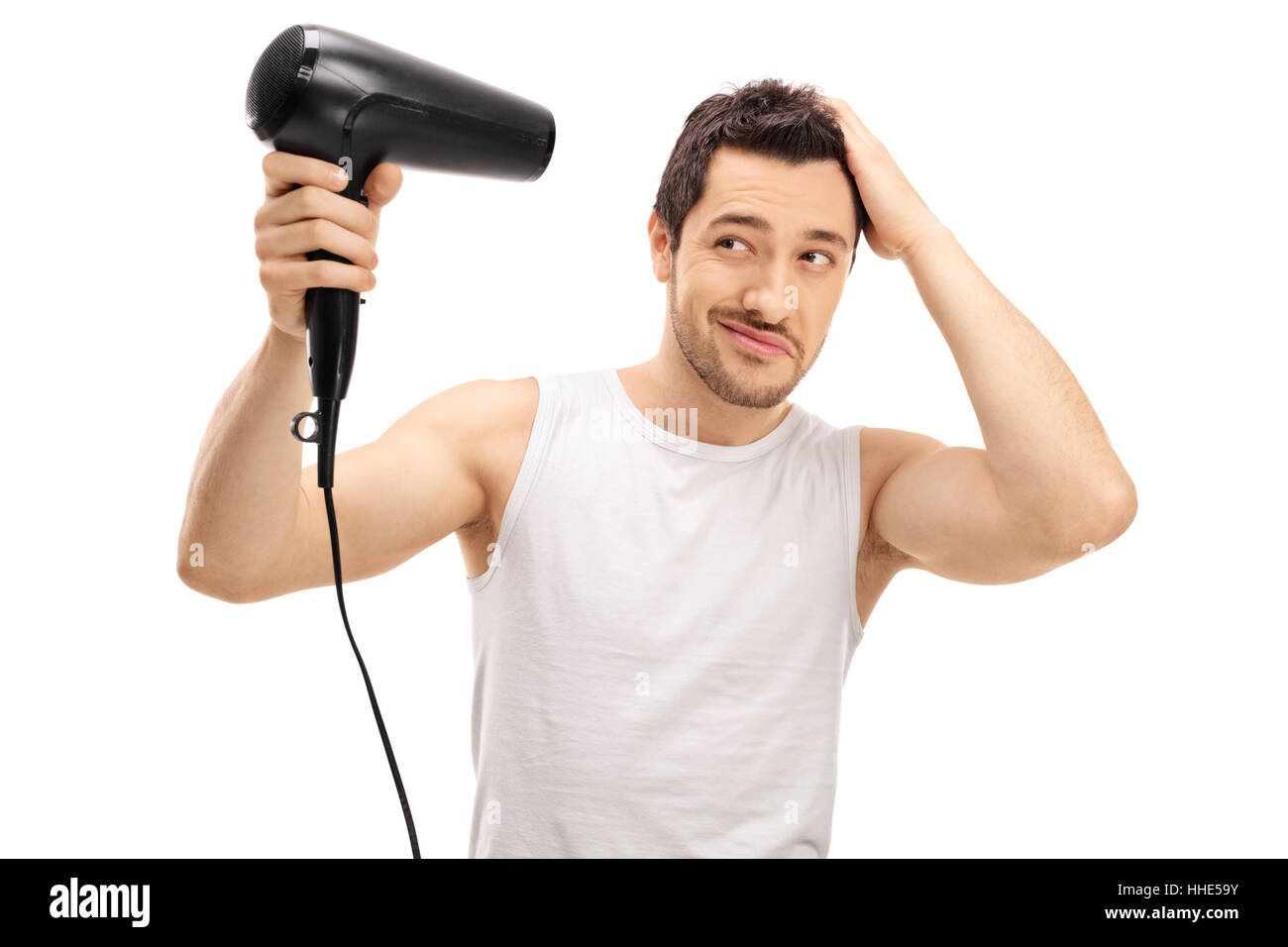 Handsome Guy Blow Drying His Hair Isolated On White Background Stock