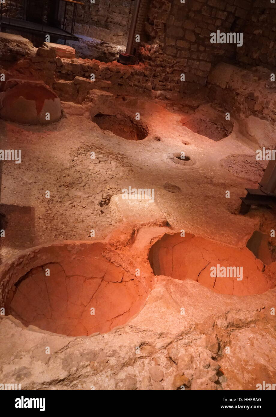 Recessed vessels used for honey and sea salt, in a wine making facility, in the Roman city, Barcelona, Spain.4th - Stock Image