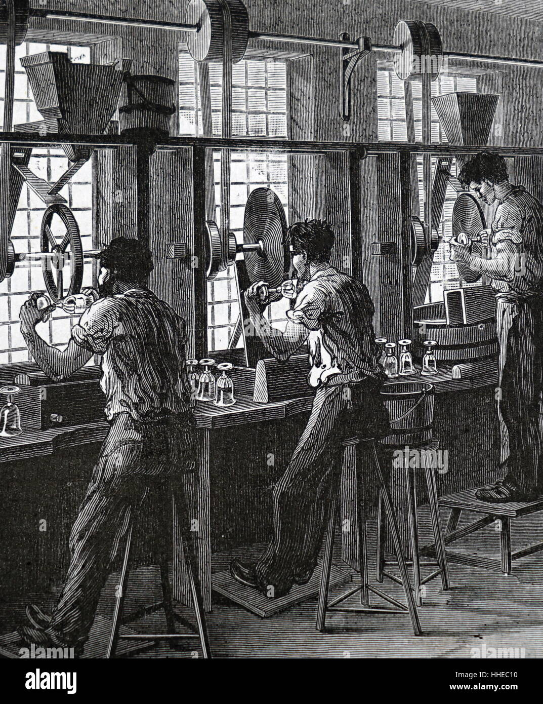 Cutting and polishing flint glass (crystal) table wares. From Louis Figuier Les Grandes Inventions, Paris, 1876. Stock Photo