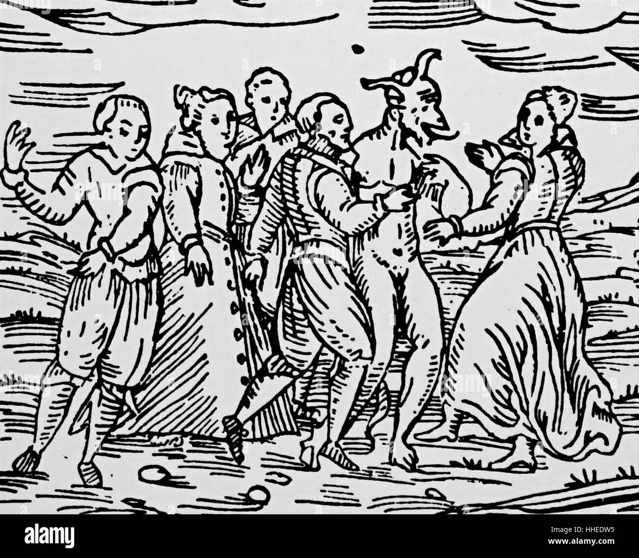 Woodcut depicting a group of witches and warlocks dancing with the Devil at the Sabbath from Compendium Maleficarum - Stock Image